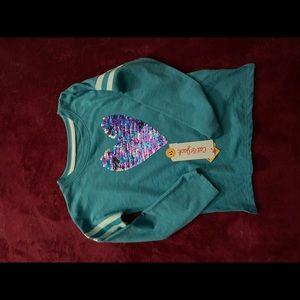 Blue shirt with flip sequins heart